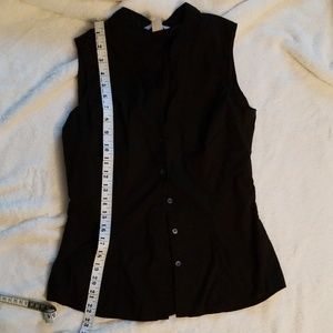 Black sleeveless blouse.
